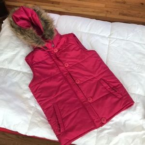 Pink puffer vest with fur lined hood